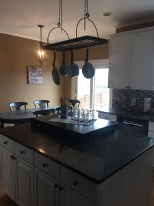 Beautiful and stocked kitchen overlooking the pool and pasture.