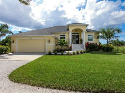 Photo for Beautiful walk to beach home - new construction - waterfront home with pool