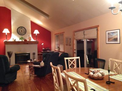 Spacious dining & living room with cathedral ceilings, skylights & fireplace!