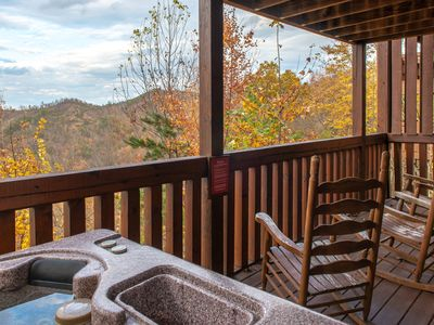 Photo for Mountain view cabin w/ shared pool, private hot tub, fireplaces, & game room