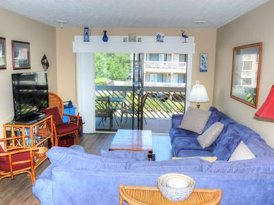 Photo for Watch the children and grandchildren at the pool from your breezy, shaded balcony in this cozy co...