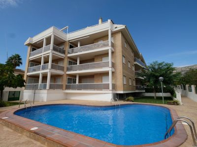 Photo for Beautiful apartment for 8 guests with A/C, pool, TV, balcony and parking