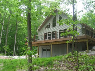 Private wooded location; spacious wraparound deck