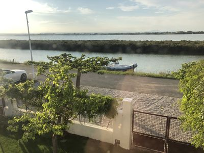 Photo for Villa with pontoon, at the edge of the canal, near the sea.