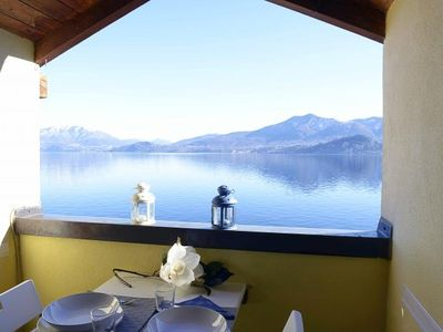 Photo for Spacious 3-room apartment with dream lake view and private beach directly on the lake
