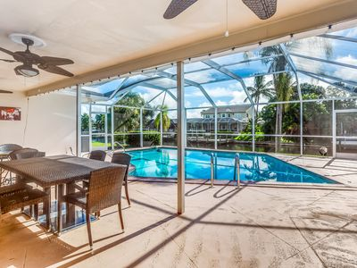 Photo for Sunny & bright canalfront home w/ private pool, furnished patio, & dock
