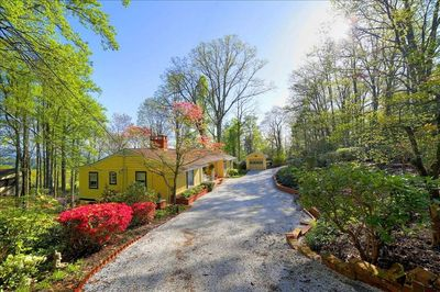 Charming quaint cottage in private setting. Detached garage.