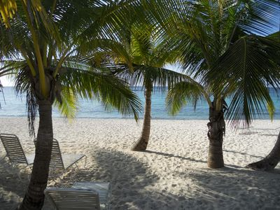 Beautiful White Sand Beach, with lots of Palms for shade.