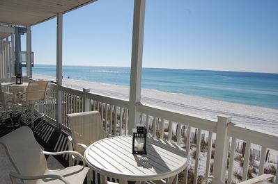 Seating for 8 on the 30 foot by 8 foot deck that sits just 5 feet above the sand