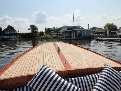 Photo for Beautiful luxury houseboat with spacious veranda directly on the Loosdrecht lakes