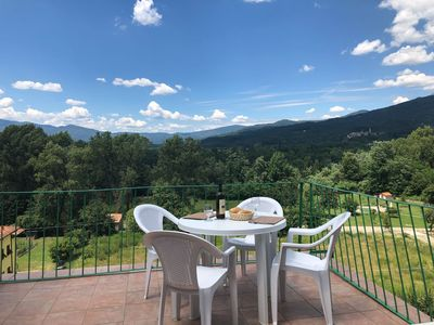 Photo for 2-bed apartment, panoramic terrace, near Olympic Pool complex in rural Tuscany