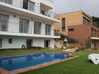 Photo for MODERN AND BEAUTIFUL HOLIDAY HOUSE IN QUIET BEACH 2 KM. LLORET DE MAR 4 KM