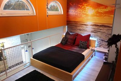 Sleeping area with cozy sunset and indirect lighting