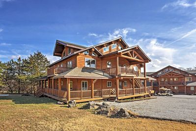 The ultimate getaway awaits you at this 10-bed, 8-bath cabin in Shell Knob!