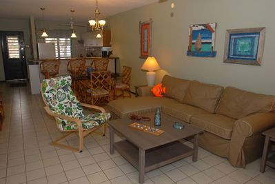 Living area with local driftwood art.  Brand new furniture!