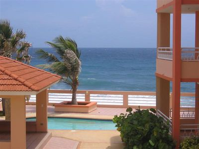 Photo for Tropical Paradise! Ocean Front Condo with the beach just steps from your door!