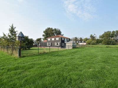 Photo for Rural apartment with spectacular views over the meadows near the beach