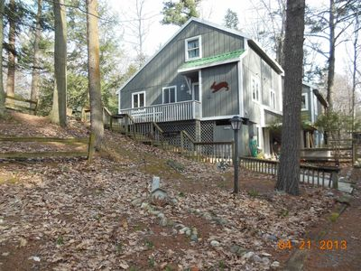 Secluded cottage with short walk to either Lk Mich beach or Portage Lk beach.