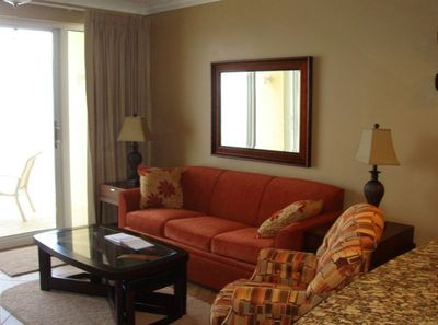 "Relax in the comfortable Living area with 42"" LCD TV and balcony access"