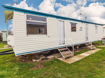 Photo for 7 berth (or 8 with cot) caravan for hire at California cliffs ref 50051