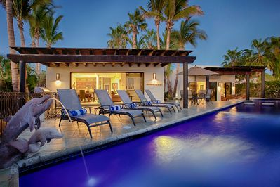 Private patio and pool with lounge chairs.
