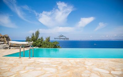 Photo for Luxurious waterfront villa with a swimming pool and access to the sea