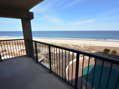 Photo for Cozy oceanfront efficiency condo with free WiFi and an outdoor pool located uptown and just steps to the beach!