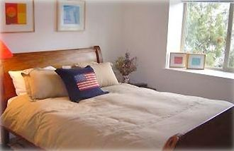 Relax in one of our three bedrooms. This room features a queen sized sleigh bed.