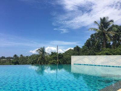 Photo for Beach Style Condo Pool, Gym, 1100m To Great Beach.