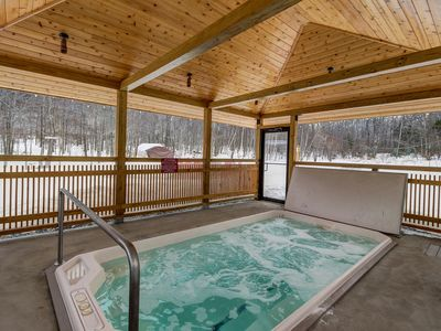 Photo for Ski-in/ski out from this cozy Vermont condo w/ shared pool, hot tub, & two decks