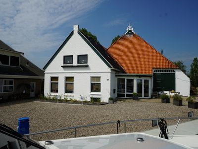 Photo for Apartments with boat on the water in Friesland (2-4 persons)