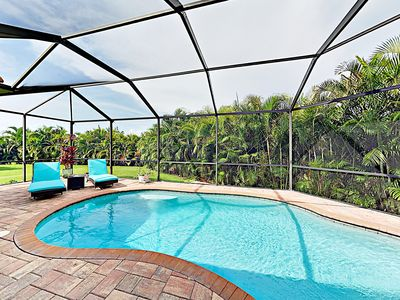Photo for New Listing! Luxurious Home in Upscale Community w/ Caged Pool & Lanai