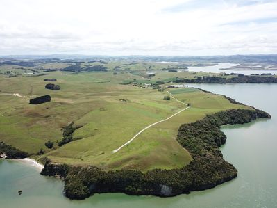 200 acres of private farmland & 3 kms of forested coastline