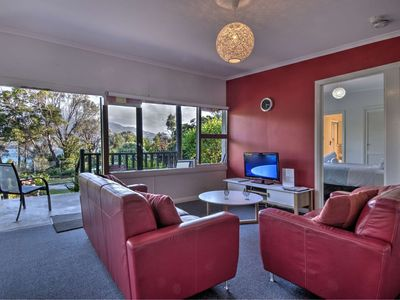 Photo for Waterfront with ocean & mountain view. Free wifi. 1 minute walk to beach.