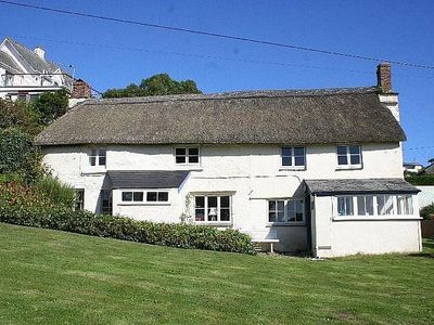 Photo for A Grade II Listed Thatched Cottage, Recently Renovated in an Ideal Location