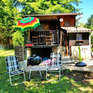 Photo for Chalet Cabane du pecheur very charming in front of the river, feet in the water
