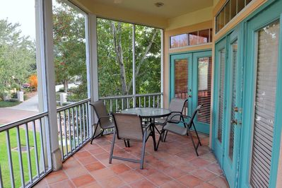Screened in patio with dining