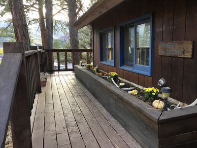 SIDE ENTRANCE UP TO LARGE DECK. ALPINE STYLE HOME