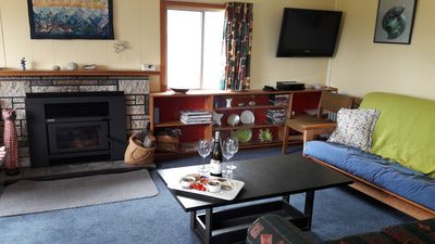 Large lounge with plenty of seating and a modern wood fire for the cooler months