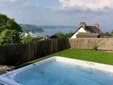 Enjoy a soak in the hot tub whilst enjoying the sea view