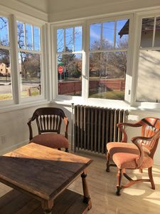 Front porch, enjoy your coffee here in the sun and plan your day!