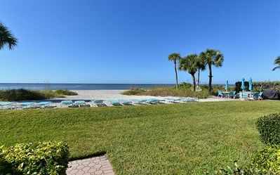 Photo for Time to relax! Enjoy the peacful, private beach just a shell's throw from your door.
