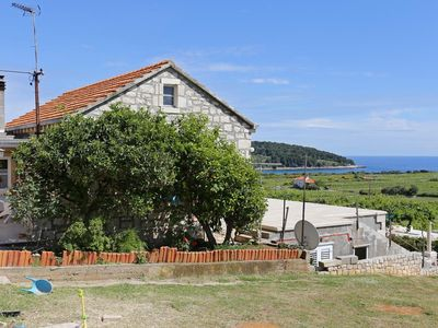 Photo for One bedroom apartment with terrace and sea view Lumbarda, Korčula (A-4429-a)
