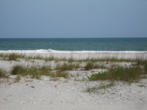ENJOY THE VIEW OF THE GULF OF MEXICO FROM THE DECK OF THIS LOVELY COTTAGE