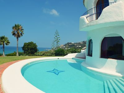 Photo for Holiday Villa with beautiful garden, views to the beach and Sunset, Sleeps 7