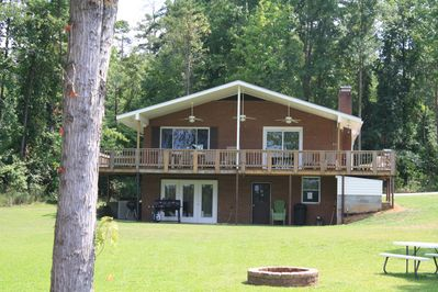 Lake side view, grills & laundry room under deck. (basement not available)