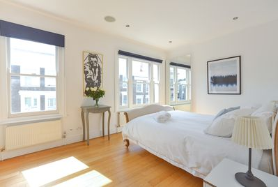 Spacious & light master bedroom with kingsize bed