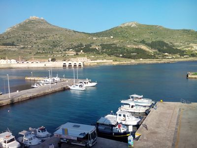 View from terrace on marina and Mount St. Catherine with Old Castle