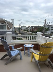 Enjoy the ocean breeze from the wrap-around porch looking towards the ocean.