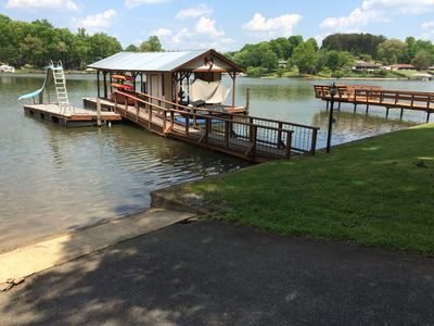 Photo for AWESOME FUN - NOTHING FANCY - Affordable Lakefront - Ramp, Dock, Water Slide!